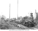 Lewis Mill and Timber Company two-truck Shay locomotive no. 1 with donkey engine in distance,...