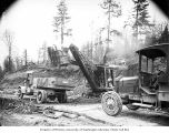 Erie steam shovel loading trucks on a plank road, Clemons Logging Company, near Melbourne, ca. 1925