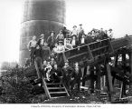 Workers beside silo and flume, Clemons Logging Company, near Melbourne, ca. 1930