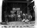 Workers at railroad shop with wheel press, B.W. Timber Company, Oregon, ca. 1927
