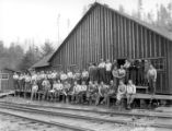Crew posing at camp behind railroad tracks, Beaver Creek Logging Company, Vernonia, ca. 1922