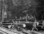 Loading crew seated on logs at landing, Bramhall Logging Company, Kerry, ca. 1912