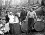Crew with woman and child on logs, Bridal Veil Timber Company, Bridal Veil, ca. 1930