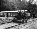 Speeder with three women and one man in front of bunkhouse, Brighton Mills Company, Brighton, ca....