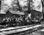 Crew posed on railroad cars at camp, Brookings Timber and Lumber Company, Brookings, ca. 1919