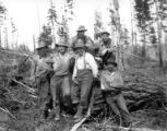 Crew seated on fallen log, Clark & Wilson Lumber Company, Oregon, ca. 1927
