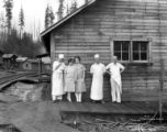 Camp cooks posing with two women, Clark & Wilson Lumber Company, Oregon, ca. 1927