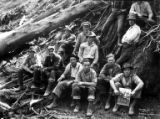 Woods crew with man holding photograph, Coos Bay Lumber Company, Powers, ca. 1930s