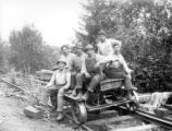 Railroad gang on speeder, Flora Logging Company, Carlton, ca. 1931