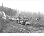 Logging camp and automobiles, Clemons Logging Company, n.d.
