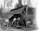 Crew members with donkey engine, Loney Logging Company, Coos Bay, ca. 1915-1945