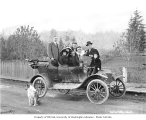 Family group in Model T touring car, probably near Hamilton, ca. 1912