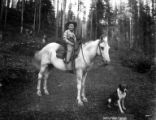 Boy on pony with dog, Potlatch Forests Incorporated, Idaho, ca. 1935