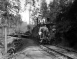 Caboose, locomotive, and railcards loaded with logs, Rock Creek logging operation, Oregon, ca....