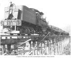 Hamilton Logging Company's two-truck Shay locomotive, with crew and loaded flatbed railroad cars...
