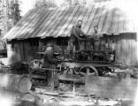 Workers tinkering with Caterpillar tractor, Shaw-Bertram Lumber Company, Klamath Falls, ca....