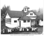 Children and teachers standing outside school building, High Point, ca. 1926