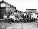 Asian crew with women and children at camp, K.P. Timber Company, Kerry, ca. 1928