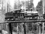 Broadside of Hammond two truck Shay locomotive #424 on trestle, Hammond Lumber Company, Oregon,...