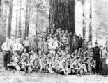 Crew posing in front of tree, Camp Gasquet, Company 5478, Civilian Conservation Corps, Crescent...