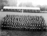 Crew group portrait in front of building, Camp Trask, Company 5477, Civilian Conservation Corps,...