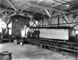 Snoqualmie Falls Lumber Co. mill interior showing big log being cut be saw, Washington, 1919