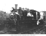 Crew aboard Independence Logging Company's three-truck Shay locomotive no. 1 at camp no. 2, ca....