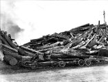Logging with a small Caterpillar and an eight wheel wagon, Washington, n.d.