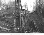 Pile driver on trestle with crew, Independence Logging Company camp no. 5, ca. 1925