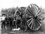 Loggers posing with big wheels, Washington, n.d.