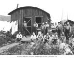 Logging crew outside mess hall at camp, National Lumber and Manufacturing Company, ca. 1920