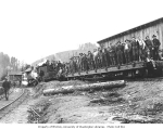 Logging crew on flat car pulled by Mud Bay Logging Company's Baldwin 2-6-2TT locomotive no. 3, n.d.