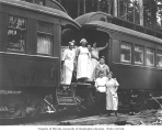Crew outside kitchen and mess hall cars, Northern Coast Timber Company, ca. 1911