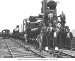 Mason County Logging Company's three-truck Shay locomotive, crew and speeder no. 4, ca. 1932