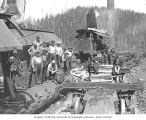 Logging crew, donkey engines, and skeleton railroad log cars, Mason County Logging Company, ca....
