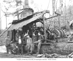 Logging crew and dog beside donkey engine, Mud Bay Logging Company, n.d.
