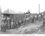 Logging crew, railroad car, and Mutual Lumber Company's Climax locomotive no. 5,  ca. 1930