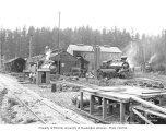 Polson Logging Company's headquarters, known as Railroad Camp, showing workshops and locomotives...