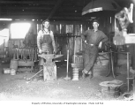 Blacksmiths in shop interior, Polson Logging Company's camp no. 8, ca. 1930