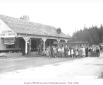Group beside bus outside Coleman's Store and Service Station, which housed the Neilton Post...