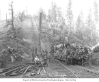 Logging crew and flat car at bottom of inclined railroad track, Saginaw Timber Company, Elma, ca....