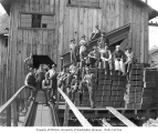 Shingle mill crew and bundles of shingles, Saginaw Timber Company, ca. 1923