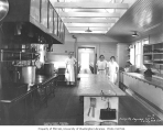 Galley crew in galley of camp no. 4, with view of mess hall in background, Saginaw Timber Company,...
