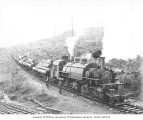 Crew with Saginaw Timber Company's Baldwin saddle-tank articulated Mallet 2-6-6-2T locomotive no....