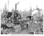 Logging crew and donkey engines beside railroad track, Merril and Ring Lumber Company, Pysht, ca....