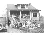 Adults and children outside a residence, probably Grays Harbor County, ca. 1931