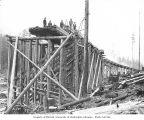 Railroad trestle under construction, St. Paul and Tacoma Lumber Company's camp no. 8, ca. 1926
