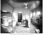Bunkhouse interior at railroad logging camp, Coats-Fordney Lumber Company, ca. 1917