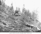 Logging crew with donkey engine and dragline and bucket, St. Paul and Tacoma Lumber Company camp...