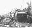 Logging crew with speeder and train, St. Paul and Tacoma Lumber Company, n.d.